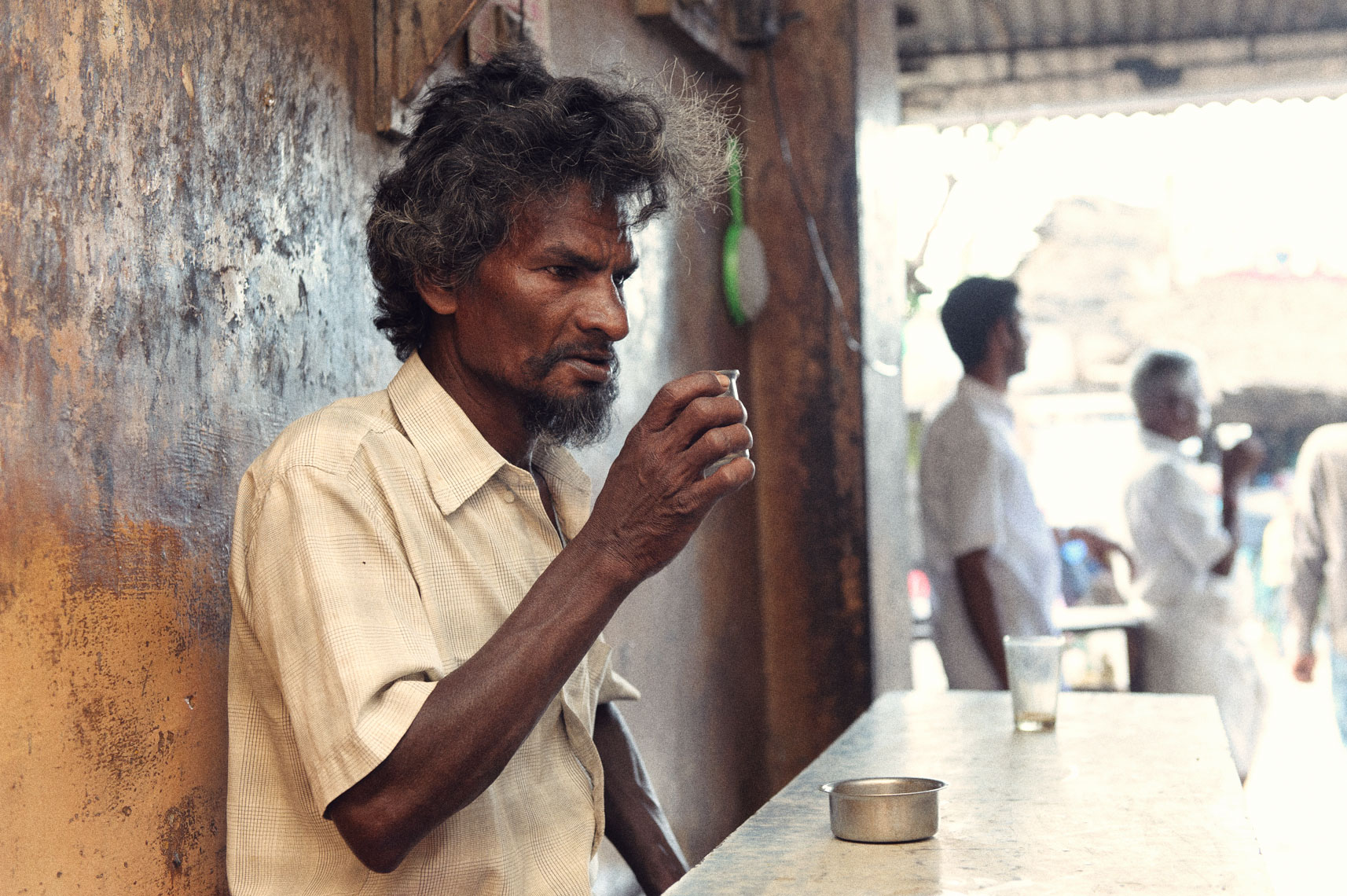 Lunch break at the tea shop, India.